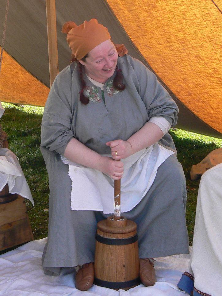 Using a Viking Period Butter Churn.